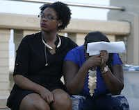 Breanna Breedlove (left) comforts her cousin Matisha Ward, daughter of Antoinette Brown, during a candlelight vigil honoring Brown in Dallas on Memorial Day on Monday. (Rose Baca/The Dallas Morning News)