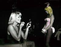 Bunny hopeful Patricia Hardy puts finishing touches on her makeup as bunny Crystal Abbott talks to another candidate during interviews at the Dallas Playboy Club, July 18, 1981.