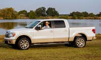 Former President George W. Bush sits in his Ford pickup in Crawford. The 2009 pickup, which was used by Bush on his Crawford ranch, will be auctioned to benefit a program dedicated to assisting U.S. military families.