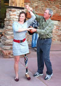 Former President George W. Bush danced with retired Army 1st Lt. Melissa Stockwell after the final day of the Warrior 100K Ride at Palo Duro Canyon State Park last year.