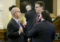 Sen. John Whitmire (left) chatted with Lt. Gov. Dan Patrick (center) and Sen. Kevin Eltife after new Senate rules were adopted in January 2015. (Jay Janner/Austin American-Statesman)
