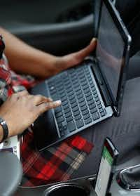 Pruitt checks an email inside her car after visiting the Dallas family. (Jae S. Lee/Staff Photographer)