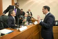 Texas Comptroller Glenn Hegar (right), talking to senators in January, said Tuesday that more Texas oil and gas companies probably will file for bankruptcy soon. (Jay Janner /Austin American-Statesman)