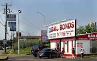 Bail bond offices advertise around-the-clock help on Riverfront Boulevard in Dallas.