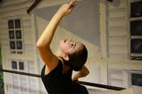 Carlee Baladez stretches during ballet practice at Stage Door. She said her goal is to become a professional ballerina.( ROSE BACA/neighborsgo staff photographer )