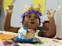 Three-year-old De'Trayveon Reed enjoys his birthday cake at the monthly birthday party at Family Gateway.