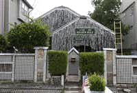 The Beer Can House, a Houston landmark featuring flattened beer cans as siding and garlands made from the lids, is one of the four Texas landmarks in the contest.( File   -  The Associated Press )