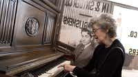 Linda Emmet, the daughter of musician Irving Berlin, plays on her father's piano at the Red Star Line museum in Antwerp, Belgium on Thursday, Sept. 26, 2013.