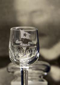 A water glass with the Red Star Line logo is exhibited at the Red Star Line museum in Antwerp, Belgium on Tuesday, Sept. 24, 2013.