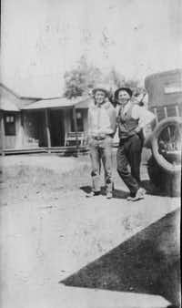 Victor Clifford Bilbo (left) posed with a driver and a motorcar from the old Bilbo Jitney Line.