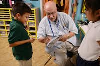 Jagers, 91, a World War II Navy veteran and author, helps Steven Aguilar, 6, with his homework at Bea's Kids, a nonprofit that provides help to students at low-income apartment complexes.ROSE BACA