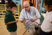 Jagers, 91, a World War II Navy veteran and author, helps Steven Aguilar, 6, with his homework at Bea's Kids, a nonprofit that provides help to students at low-income apartment complexes.(ROSE BACA)