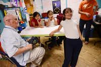 Bob Jagers, 91, a World War II Navy veteran and author, jokes around with Ana Rocha, 7, after a tutoring lesson at Bea's Kids, a nonprofit that provides help to students at low-income apartment complexes.ROSE BACA