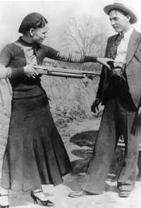 Bonnie Parker playfully pointed a rifle at Clyde Barrow in a photo taken during their deadly two-year crime spree in the early 1930s.File  -  The Associated Press