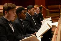 Colby Ewatuya (second from left), a senior at Booker T. Washington High School, sings during rehearsal at the Meyerson Symphony Center. Colby, who will attend Boston's Berklee College of Music, and My'kal Stromile (below), who will study at Juilliard School in New York, were selected as U.S. Presidential Scholars in the Arts — two of 20 recipients across the country.Photo by ROSE BACA  - neighborsgo staff photographer