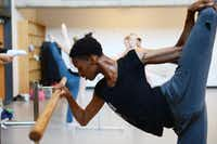My'kal Stromile stretches during ballet class at Booker T.Photo by ROSE BACA - neighborsgo staff photographer