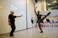 Ballet master Ceyhun Ozsoy gives instruction to My'kal Stromile, 18, during a ballet class at Booker T. Washington High School in Dallas. Stromile, who will study at the Juilliard School in New York, and Colby Ewatuya, who will attend Boston's Berklee College of Music, were selected as U.S. Presidential Scholars in the Arts — two of 20 recipients across the country.( Photo by ROSE BACA  -  neighborsgo staff photographer )