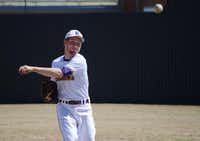 Austin Bowden, 16, first baseman on the Richardson High School varsity baseball team, warms up before a game against Sunset High School on March 11, at Richardson High School. Later this year, Austin and his brother Gavin, 14, will play on the Great Britain 16U National Team.(Rose Baca - neighborsgo staff photographer)
