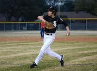Gavin Bowden, 14, first basemen for his North Garland Little League Team, throws the ball during a practice in Garland.Rose Baca - neighborsgo staff photographer