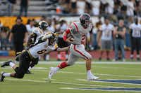 McKinney Boyd quarterback Curtis Ladd slips away from a Garland defender on Sept. 12. Ladd threw for 200 yards and two touchdowns and also ran for 71 yards rushing in the 51-9 victory. Boyd plays Rockwall at 7:30 p.m. Friday Rockwall's Wilkerson-Sanders Stadium.