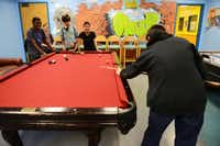 Braden Schroeder , 13, shoots pool, while (from left) Kameron Jackson, Matthew Haghirian, Rico Jones and Allan Hilley watch.(Rose Baca - neighborsgo staff photographer)