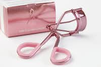 A Sephora Collection Pink Eyelash Curler is displayed in Philadelphia. Such products have caused breast cancer advocates to ask whether breast cancer awareness has lost its focus, and become more about marketing than women's health.