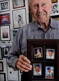 Bobby Brown, 88, holds some vintage baseball cards of himself at his home in Fort Worth.  He is one of the last New York Yankees players from the 1940s era. After baseball, he became a doctor.