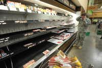 The Fort Carson commissary in Colorado Springs, Colo., offered fewer options than usual Tuesday. Business was brisker than usual after the store said it would close until further notice because of the government shutdown.
