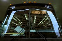Passengers at Greyhound's downtown Dallas station board one of the new Express buses for Houston.
