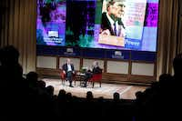 Former President George W. Bush and author Jon Meacham talk during a discussion of author Meacham's biography of President George H.W. Bush Sunday at the George W. Bush Presidential Center in Dallas.(Rachel Woolf - Staff Photographer)
