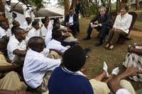President George W. Bush and first lady Laura Bush met in 2008 with members of the Anti-AIDS Club at a school in Kigali, Rwanda. Thanks largely to U.S.-supplied drugs, the HIV/AIDS death rate in the country plummeted from 190 per 100,000 people in 2000 to 41 in 2009.