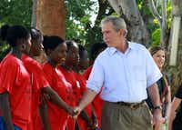 President George W. Bush greeted Zambian girls in Lusaka in December during a tour to promote efforts to fight diseases such as AIDS, cancer and malaria. His SMU-based presidential institute is leading an $85 million campaign against women's cancers.
