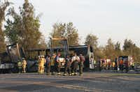 Rescue workers, police and firefighters work the accident in northern California in which nine people were killed in a three-vehicle crash. The wreck involved a bus carrying high school students on a visit to a college, a FedEx truck and a Nissan Altima.(Greg Barnette - The Record Searchlight)