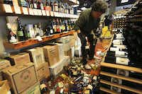 Dan Dawson cleans up his ruined inventory at his store, Back Room Wines, in Napa, Calif., where a  6.0 magnitude earthquake caused substantial damage around 3:20 a.m. on Aug. 24, 2014. Centered about six miles south of Napa, the quake was the most powerful in the San Francisco Bay Area since the Loma Prieta quake of 1989, which collapsed the Bay Bridge. (Jim Wilson/The New York Times)JIM WILSON - NYT
