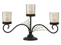 CREEPY CANDELABRUM: The votive holder includes mercury glass that emits a spooky shimmer. $15. Target stores only (not online).