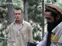 FILE - This file image provided by IntelCenter on Dec. 8, 2010, shows a frame grab from a video released by the Taliban containing footage of a man believed to be Bowe Bergdahl, left.  Saturday, May 31, 2014, U.S. officials say Bergdahl, the only American soldier held prisoner in Afghanistan has been freed and is in U.S. custody. The officials say his release was part of a negotiation that includes the release of five Afghan detainees held in the U.S. prison at Guantanamo Bay, Cuba.(Uncredited - AP)