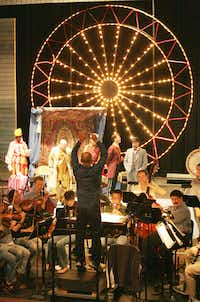 Conductor Jay Dias, from New York,center, for the first time in 62 years, uses the original score and a full orchestra, during a dress rehearsal of Carousel by Lyric Stage at the Irving Arts Center's Carpenter Performance Hall in Irving Wednesday September 05, 2007.Ricky Moon - 122363