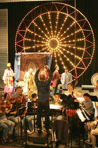 Conductor Jay Dias, from New York,center, for the first time in 62 years, uses the original score and a full orchestra, during a dress rehearsal of Carousel by Lyric Stage at the Irving Arts Center's Carpenter Performance Hall in Irving Wednesday September 05, 2007.(Ricky Moon - 122363)
