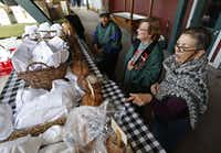 Carol Person (left) of Plano, Cindy Telisak (center) of Parker, and Gail Stryker of Plano, support a baked bread venfor at the the Collin County Farmers Market in Plano which was having their opening day on Saturday, April 20, 2013.Stewart F. House - Special Contributor