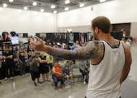 Jarett Nobles of Dallas shows his sleeve to the audience during the Dallas Art and Tattoo Expo at the Irving Convention Center in Irving,. (Vernon Bryant/The Dallas Morning News)