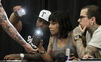 Lance Smith of Rockwall (left) gets his sleeve judged by judges Rapheal Brown of Houston (left center), Charlotte Cdebaca of Austin and Cody Dresser of Mansfield (far right) during the Dallas Art and Tattoo Expo at the Irving Convention Center in Irving,. (Vernon Bryant/The Dallas Morning News)