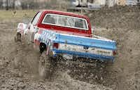 "Calvin Corbett of Windom drives his Chevy Truck, ""Brutus,"" through the mud at the Nevada Mud Pits during the mud-bogging season opener.( Photo by Stewart F. House  -  special contributor )"