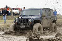 Colby Smith churns through the mud while competing at the Nevada Mud Pits. The Pits include two, 25-foot-wide by 200-foot-long mud pits.(Stewart F. House - Special Contributor)