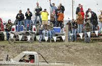 Mud flies into the crowd as a truck races against the clock at the Nevada Mud Pits during the mud-bogging season opener.( Photo by Stewart F. House  -  special contributor )