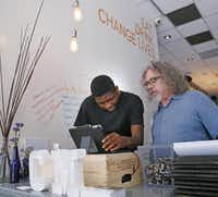 Malik Runnels (left) asks a question to Kenneth Pyron, director of operation at Café Momentum.(Kye R. Lee - Staff Photographer)