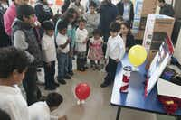 Siddarth Balaji,5, right, demonstrates his science project of a hovercrafts made of cd's and balloons during the Children's Garden Montessori Academy Pre-K Science Fair on Saturday, Feb. 21, 2015.   (Rex C. Curry/Special Contributor)(Rex C. Curry - Special Contributor)