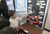 Daniel Betancourt 5, describes his science project on the human digestive system during the Children's Garden Montessori Academy Pre-K Science Fair on Saturday, Feb. 21, 2015.   (Rex C. Curry/Special Contributor)(Rex C. Curry - Special Contributor)