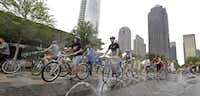 Bicyclists left Klyde Warren Park en route to the Katy Trail on Monday during the Uptown Ciclovía, an event promoting biking and walking. Parts of Cedar Springs Road and Harwood Street were closed to cars, and the route was lined with booths and filled with activities.( Brandon Wade  - Special Contributor)