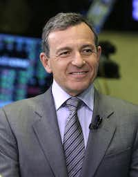 FILE - In this Tuesday, March 12, 2013, file photo, Bob Iger, chairman and CEO of The Walt Disney Company, is interviewed on the floor of the New York Stock Exchange. Iger was the seventh highest paid CEO in 2013 at $34.3 million, as calculated by The Associated Press and Equilar, an executive pay research firm. (AP Photo/Richard Drew, File)Richard Drew - AP