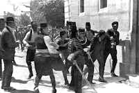 Gavrilo Princip (right) was captured by police in Sarajevo, Yugoslavia, on June 28, 1914, after he assassinated the Archduke Franz Ferdinand, heir to the Austrian-Hungarian throne, and his wife, triggering the clash of alliances that became World War I.